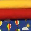 Luftballonger på blå botten trikåtyg