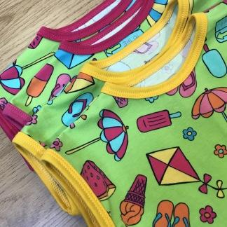 T-shirt barn strandlek - T-shirt strandlek cerise kant stl 80