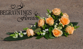 Liggande arrangemang - Apricos rosor (enligt bild)