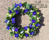 Formbunden krans - Blommor, blåmusselskal & sjöstjärnor
