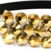 Hårsmycke till knut el tofs - Guldstenar m svart resår S