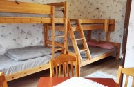 Room 4, Kvarnaryd. Family room, up tp 5 people. This room includes 2 bunk beds, table and chair, wardrobe and sink.