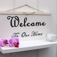 Handtextad ljushylla - welcome to our home
