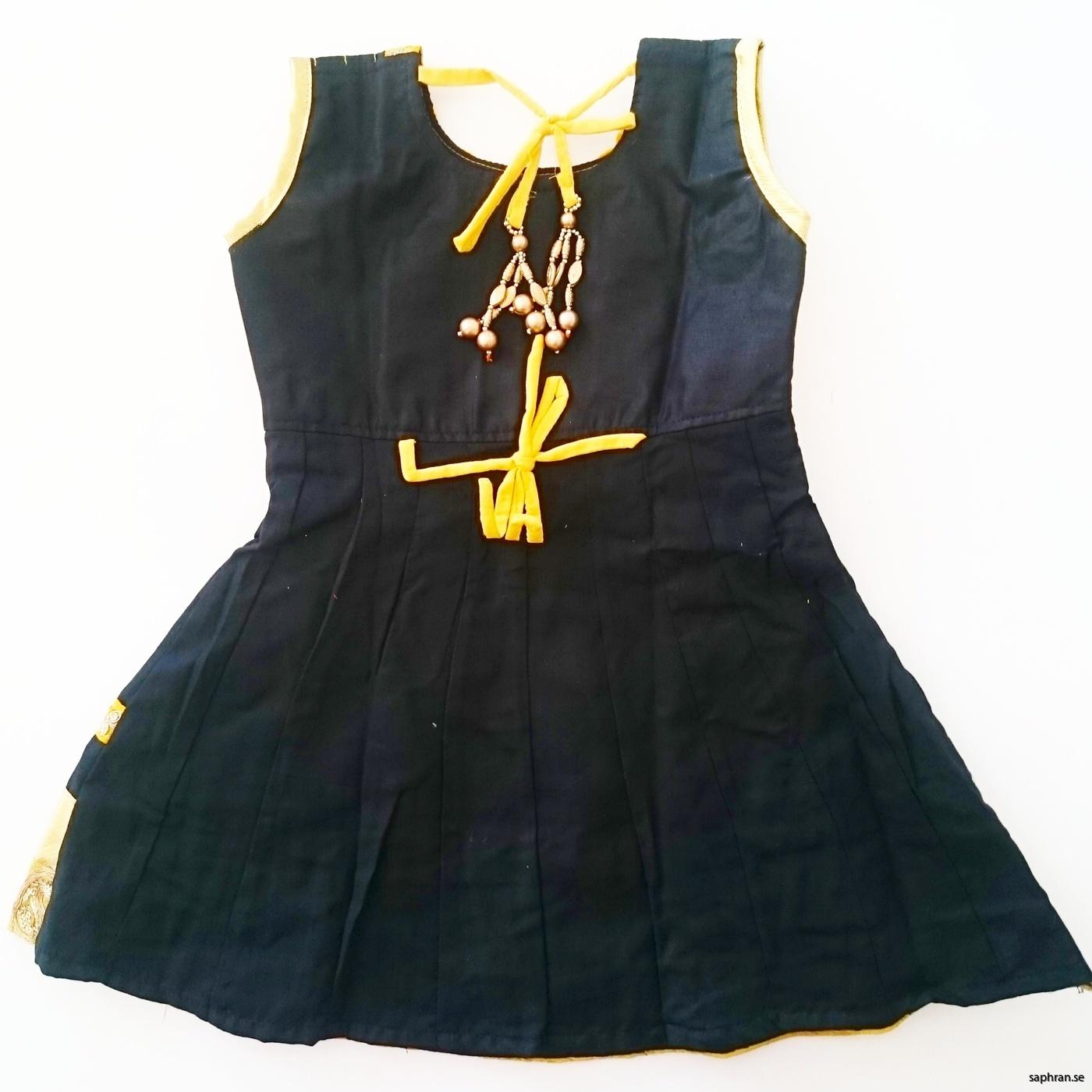 Indisk barnklänning svart och gul