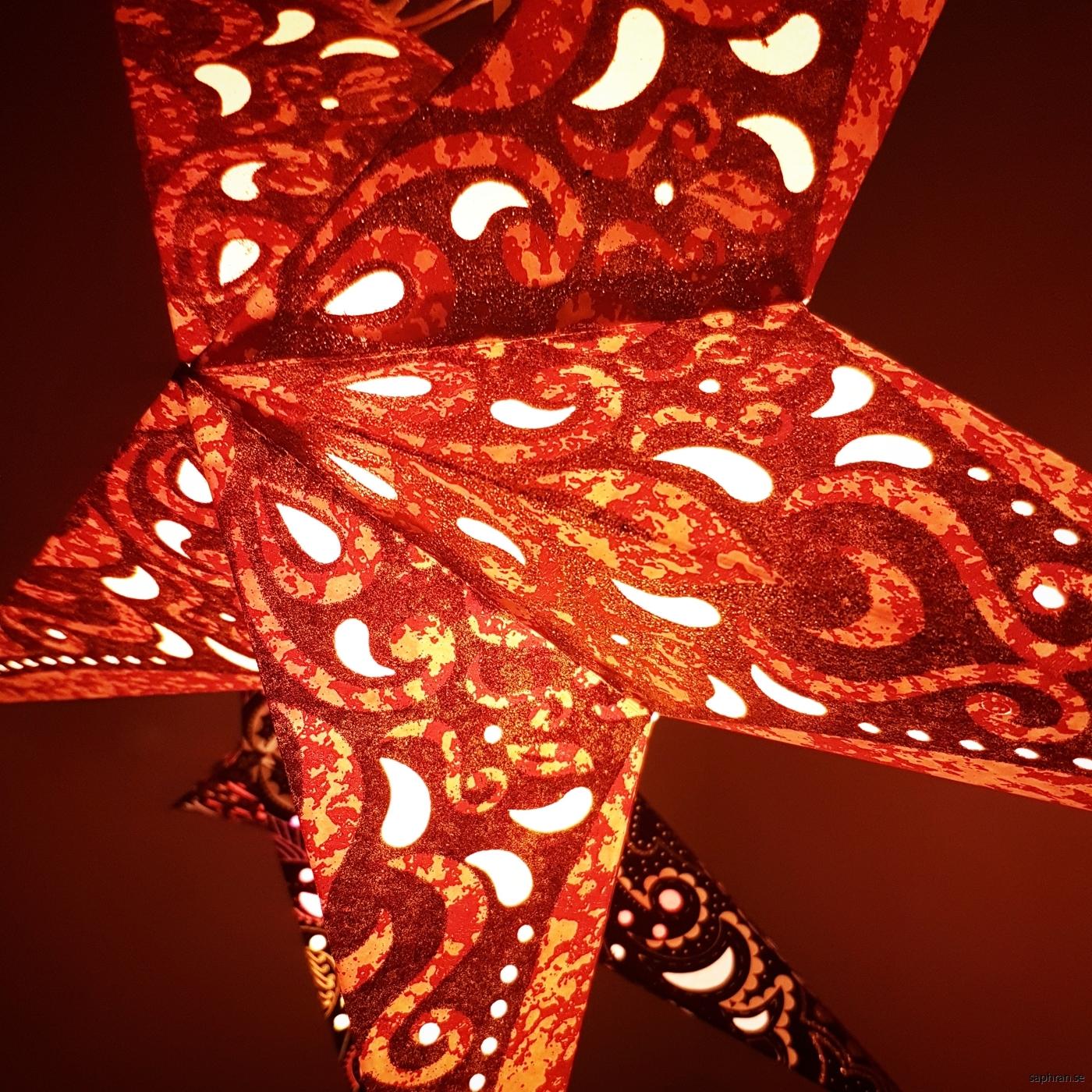 Glittrig orangeröd julstjärna