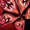 Glittrig färgglad julstjärna/adventsstjärna - SVARTORANGE