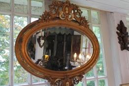Oval facettslipad spegel