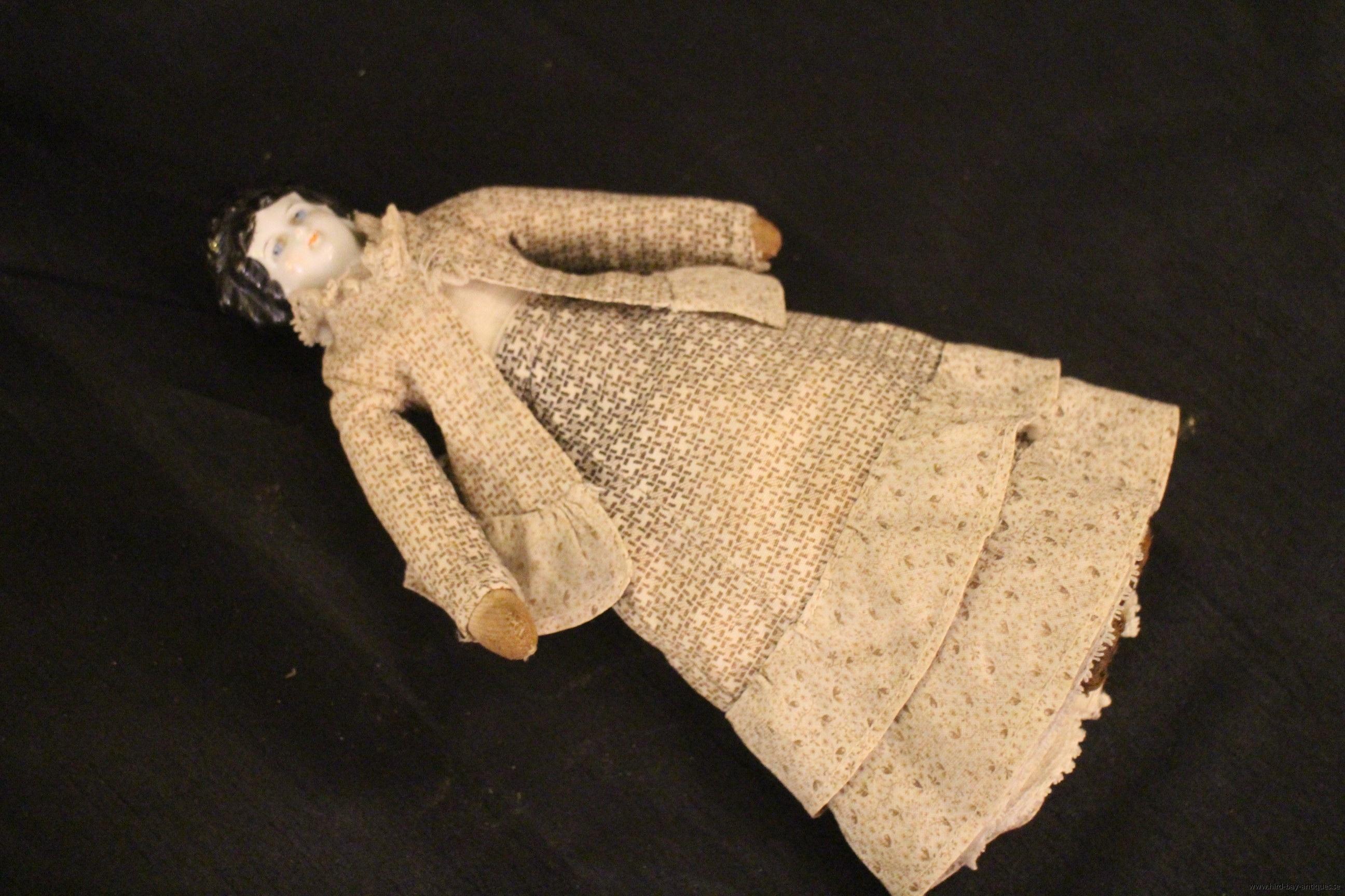 gammal porslinsdocka docka porslins huvud