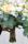 Detaljbild på handtag till brudbuketten och tärnbuketterna i jutesnöre, ger en lantlig känsla