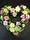 Hjärta i blommor till begravning i pastell
