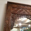 Spegel av återvunnet trä