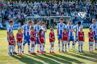 Landvetter IF girls team born 2008 as mascots during Swedish Cup match, Landvetter IS – IFK Göteborg, August 2017.