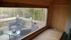 Vy ifrån bastutunna med fönster på långsidan