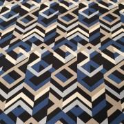 Grafiskt mönster i blå, svart och beige toner