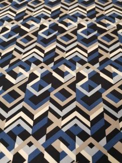 Grafiskt mönster i blå, svart och beige toner - Grafiskt mönster i blå, svart och beige toner