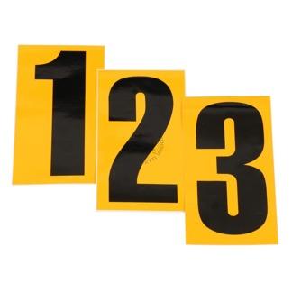 Siffror i svart med gul bakrund