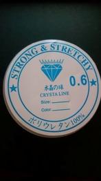 0,6 mm - Crystal tråd, klar och kraftig , 0,6 mm tjock , 10m / rulle