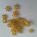 Snöflinga guldpläterad 8,5x2,5 mm. 50 stk