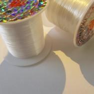 Elastisk fibertråd, platt. 0,8 mm.