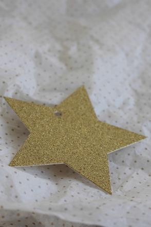 Etikett glittrig guldstjärna