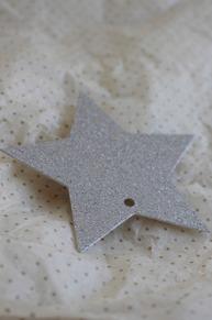 Etikett glittrig silverstjärna