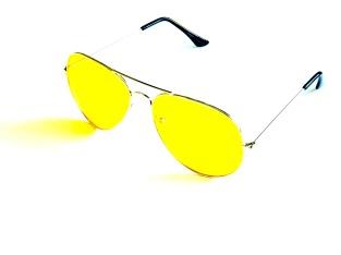 Solglas gula pilot med ljus båge
