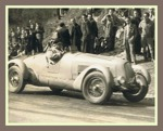 "Grandfather driving  one racing cars: ""Scuderia Roma""."