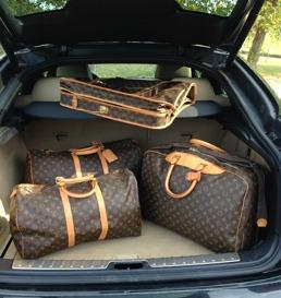 Travelkit från Louis Vuitton bestående av Alize, Keepall och Garment.