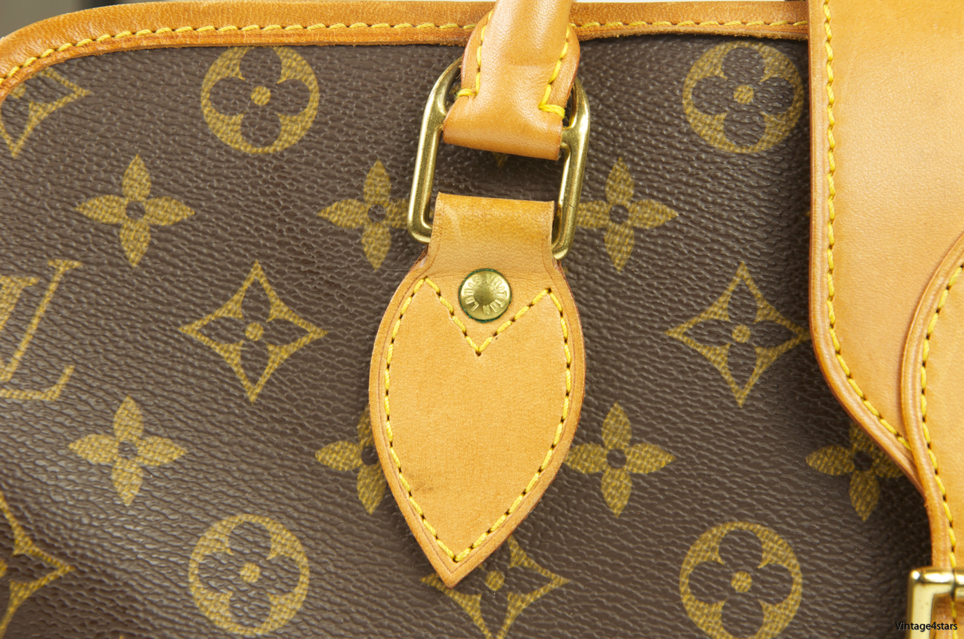 Louis Vuitton Rivoli Monogram 103