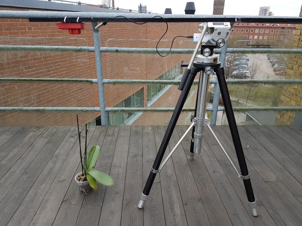 Fig 2. The camera calibration starts on the roof of the department. Close pictures of reflective targets and other features, as vegetation, are taken. Right after the picture, the reflectance is measured with the spectrometer. Photo by Ximena Tagle.