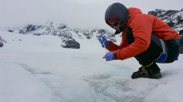 Karen sampling surface ice communities in early September as the glacier melt slows for the season. Photo credit Michael Gardner.