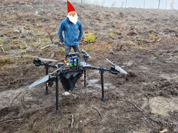 "A model XL drone demonstrated its ability to fertilize GPS positioned plants during the ""Future silviculture"" excursion at Degerön (part of the Vindeln Experimental Forest at Svartberget). It got Santa Claus thinking, should he consider using a drone instead of Rudolph to lead his sleigh this year? Phto: Johan Westin."