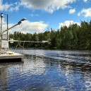 Floating platform on Erssjön at Skogaryd Research Catchment, equipped with a variety of different sensors measuring physical variables below the surface and fluxes above. Photographer: Holger Villwock