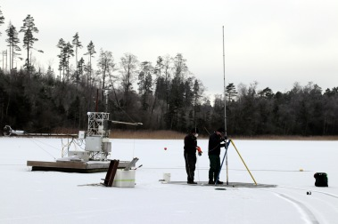 Two master students, Fredrik Andersson and Tobias Möhl, participated in the sampling. Here they are pulling the geo-radar (Malå Geoscience Ramac) equipment over the ice. Photo: Leif Klemedtsson.