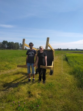 Intern Pierre Mothes (left) and research assistant Sanna Bergquist (right) are removing the Liefplan equipment before the second harvest of grass. Photo: J. Wallsten