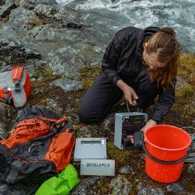 Field assistant Linnea Huusko conducts measurements at Lillsjön, Tarfala Valley. Photo: Karuna Sah.