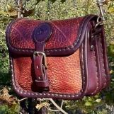 Liten bred handväska