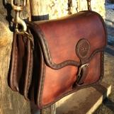 Liten kurvig handväska