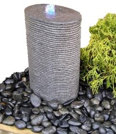 vattensten, fontänsten , dammprodukter, vatten i trädgården