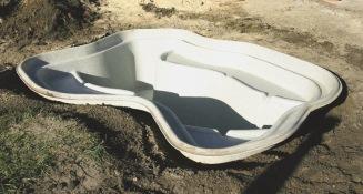 anlägga formpressad damm i trädgård