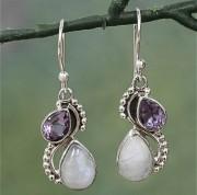 Örhänge med droppar av vit cateye sten och lila kristall