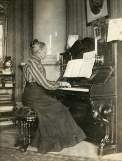 Mother Sophia Wilhelmina Peterson (maiden name Berger) at her harmonium/ pump organ in Umeå. She introduced her son to music.