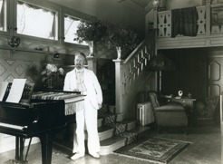 PB at home in white linen suit.