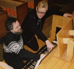 Two organists, trying out the organ in St Peter's church, Manhattan, New York.