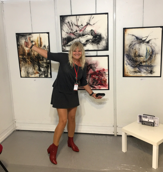 Dana with her artworks