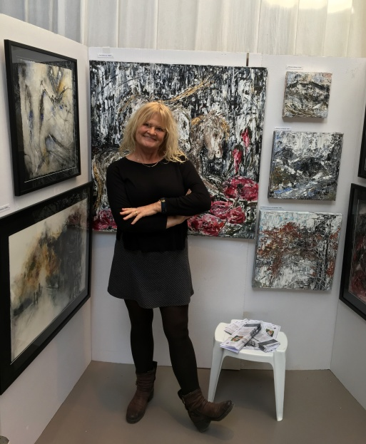 Dana Ingesson with her artworks in Stockholms Konstsalong