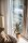 vecteezy_plant-and-couch-beside-window_1248254