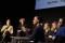 Syntolkning: Samtal på scen, Alice Bah Kuhnke i förgrunden. Foto: José Figueroa