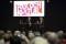 Syntolkning: Stor publik framför scen där Ulf Kristersson och Nedjma Chaouche talar. Foto: José Figueroa