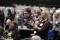 Syntolkning: Stor publik med fokus på en man iklädd samisk kolt och mössa. Foto: José Figueroa